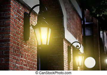 Vintage light lamp on the brick wall