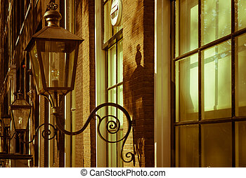 Vintage lights on the buildings in the old city of Amsterdam. Retro colors
