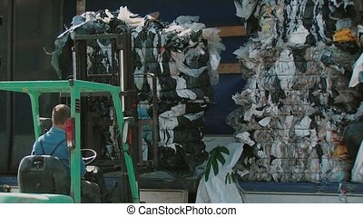 Vintage Loader work at recycling factory with paper and...