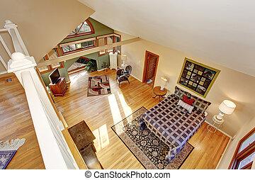 Vintage loft style bedroom with tv and hardwood floor. -...