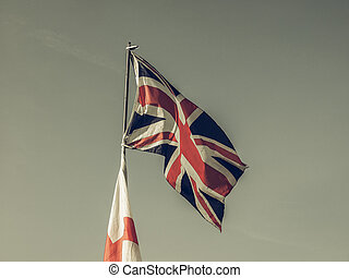 Vintage looking Flag of UK over blue sky