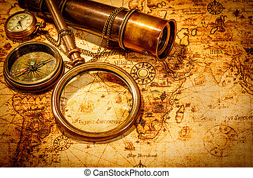 Vintage magnifying glass lies on an ancient world map - ...