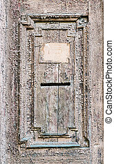 Vintage mail slot in a wooden door
