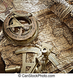 vintage still life with compass, sextant and old map