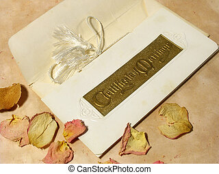 vintage marriage certificate with dried rose petals