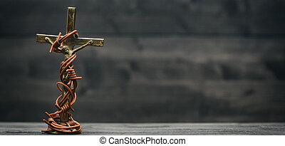 Vintage Metal Crucifix, Bronze Tone, Religious Icon Art, Jesus Christ with barbed wire on black wooden background