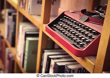 Vintage metal keyboard machine in the bookshelf