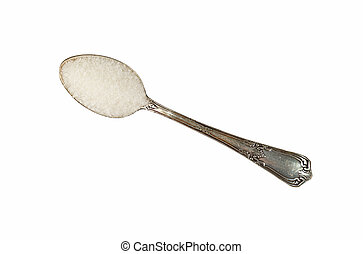 Vintage metal spoon full of white sugar isolated