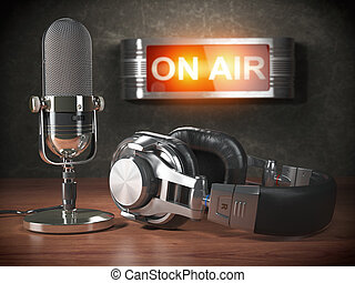 Vintage microphone and headphones with signboard on air. ...