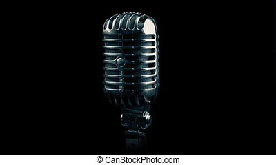 Vintage Microphone Rotating On Black - Classic old...