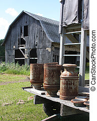 Vintage Milk Cans on a hay wagon
