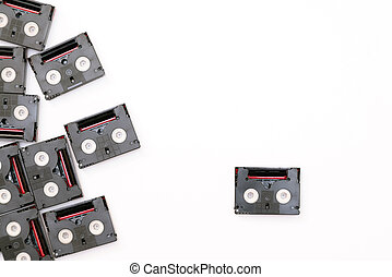 Vintage mini DV cassette tapes used for filming back in a day. Random pattern made of plastic video tapes on white background
