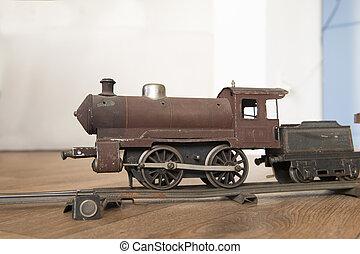 Vintage miniature locomotive at the floor