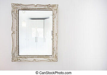 vintage Mirror On The white Wall simple and clean decoration