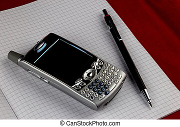 Vintage Mobile Phone with Pencil on Squared Paper