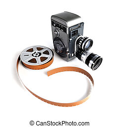 Vintage Movie Camera and Film - Vintage movie camera with a...