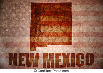 new mexico map on a vintage american flag background