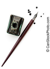 Vintage nib pen and inkwell, isolated on white with ink drops. Overhead view.