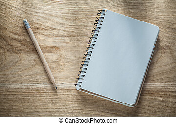 Vintage notepad pencil on wooden board