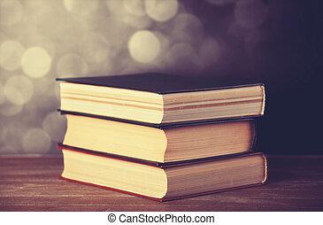 Vintage old books on wooden deck tabletop