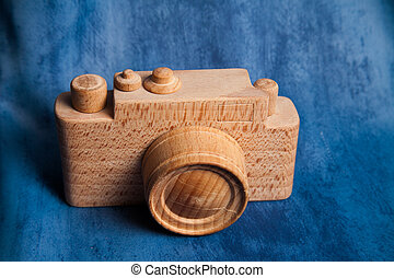 vintage old camera on brown wooden background. room for text...