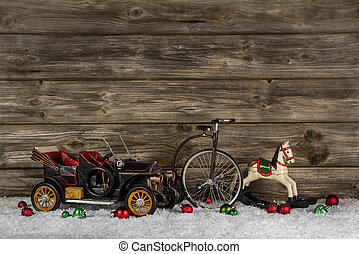Old antique children toys of wood and tin for christmas decoration on wooden rustic background.