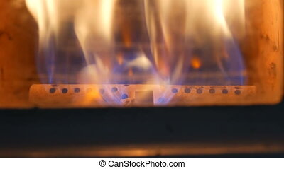 Vintage old gas fireplace in which fire burning close up view