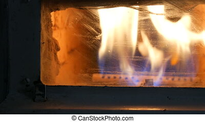 Vintage old gas fireplace in which fire burning close up...