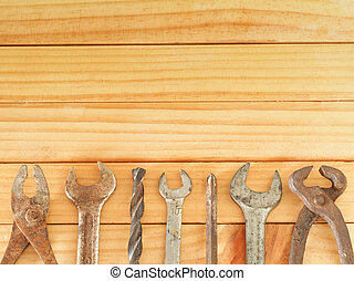 Vintage old rust tool, screwdriver, wrench, drill, hex key, construction tools on wooden background with copy space at top. Working tools background. Father's day concept.
