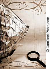 ship and reading glass