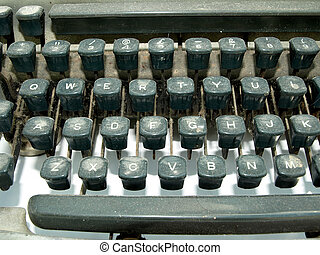 Vintage old type writer detail showing the qwerty keys