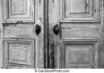 Vintage old wooden door with cracks background texture, peeling paint retro design black and white