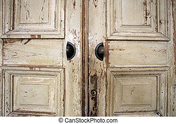 Vintage old wooden door with cracks background texture, peeling paint retro design