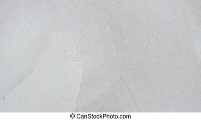 Vintage or grungy white background of natural cement or stone old texture as a retro pattern wall. It is a concept wall banner, grunge, material, aged construction with space for text. Video footage 4K. Horisontal moving.