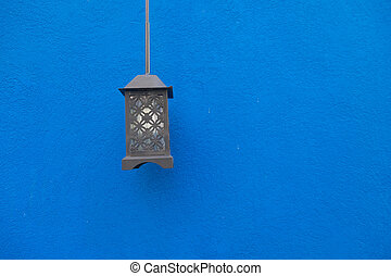 Vintage or retro lamp on blue wall