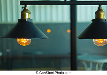 Vintage or retro lamp on old wall in home