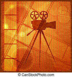 Vintage orange background with the silhouette of movie...