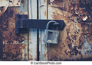 vintage padlock on rusty door, locked old door