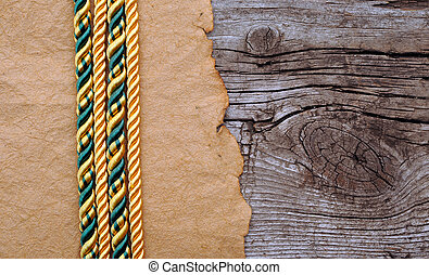 Vintage paper and color rope on old wooden boards