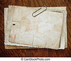 Vintage paper card on wooden texture - Vintage background...