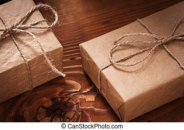 vintage paper giftboxes on old wooden boards