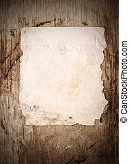 vintage paper on grungy wood texture