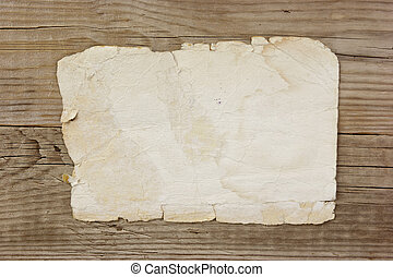 vintage paper page on old wooden boards