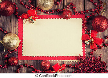 vintage paper with christmas decoration on wooden background