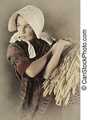 Reenactment image of a victorian peasant girl holding a basket