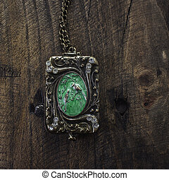Vintage pendant on wooden background