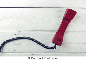 vintage phone handset on white wood background. top view with copy space