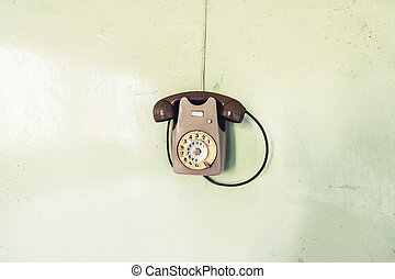 vintage phone on the wall - objects and places lost in time