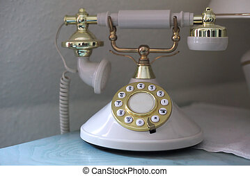 Vintage phone with a golden dial plate