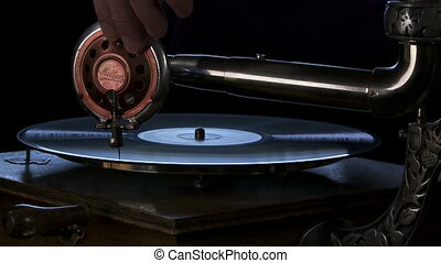 Vintage phonograph player - Medium close shot of an antique...